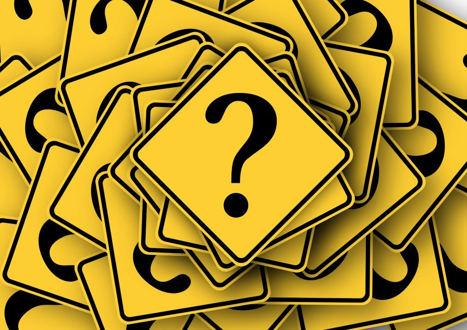 Placards with question marks remind us to ask specific questions before determining a project budget